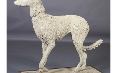 A ceramic figure of a lurcher, on naturalistic base and wood...