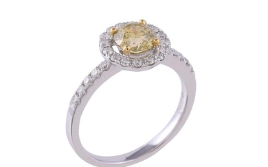 A diamond and yellow diamond cluster ring