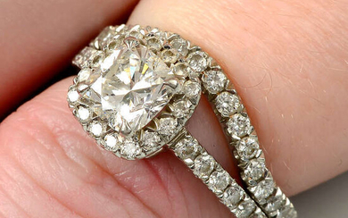 A platinum diamond cluster ring, with matching shaped band ring, by Boodles.
