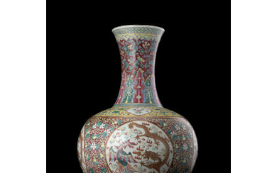 A large ruby-ground Famille Rose bottle vase decorated with phoenix and dragons, the neck with floral motifs (restorations) China, Qing…Read more