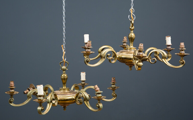 A pair of brass six branch chandeliers