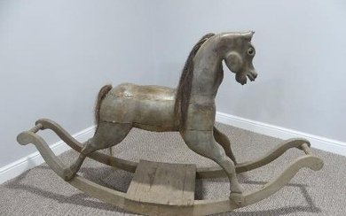 A vintage carved wooden Rocking Horse on bow rockers, with r...