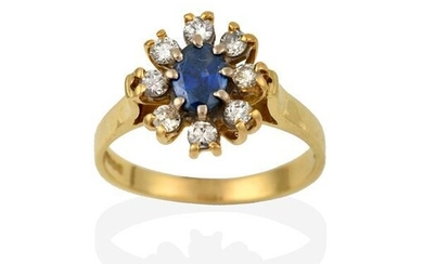 An 18 Carat Gold Sapphire and Diamond Cluster Ring, the...