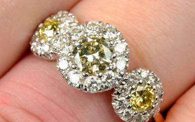 An 18ct gold brilliant-cut 'yellow' diamond and diamond triple cluster ring.