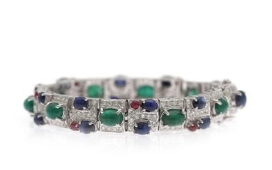 NOT SOLD. An emerald, sapphire and diamond bracelet set with numerous diamonds and numerous emeralds,...