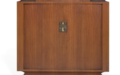 NOT SOLD. Ernst Kühn: Brazilian rosewood cabinet with curved sides and base with brass plinth....