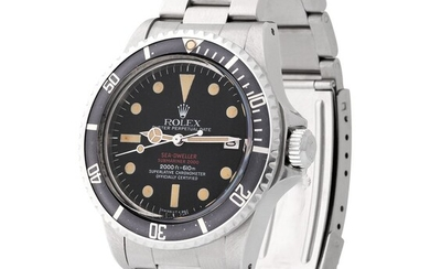 "Rolex. Sought after and Desired Sea Dweller ""Double Red"" Automatic Wristwatch in Steel, Reference 1665, With Black Dial and original Warranty"