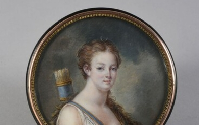 TABATIERE.In black tortoiseshell, round shape, decorated on the lid with a miniature portrait painted on ivory representing Queen Marie-Antoinette as Diana the Huntress, preserved under a curved glass in a gilded copper frame. Containing inside a...
