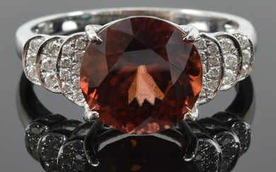 14K white gold zircon and diamond ring. Round faceted