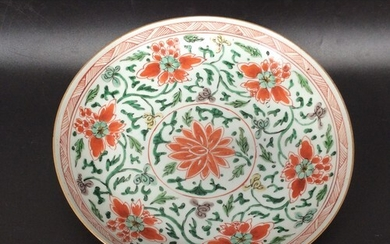 A Chinese 'famille vert' porcelain dish decorated with green...