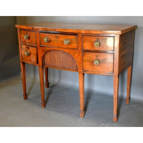 A George IV Mahogany Bow Fronted Sideboard with an arrangeme...