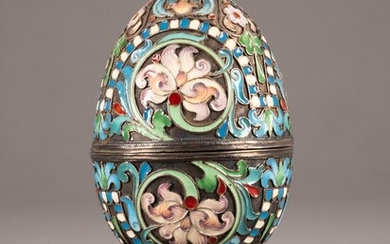 A SILVER AND CLOISONNÉ ENAMEL EGG-SHAPED BOX ON STAND