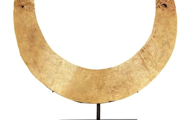 A gold torque necklace in the ancient style, mounted on stand, 17.5cm. diam., 24 grams Provenance: Private Collection Oliver Hoare (1945-2018); David Aaron Ancient Art May 1999
