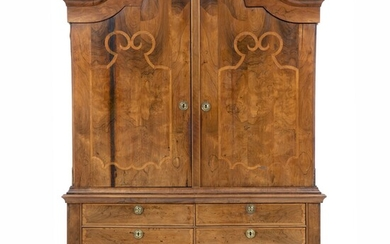 A large German Rococo walnut intarsia cupboard. Second half of the 18th century. H. 240...