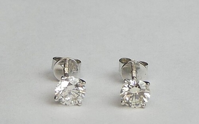 A pair of 18ct white gold diamond stud earrings, approx 1ct....