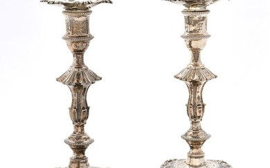 A pair of George III cast silver candlesticks, with shells, ...