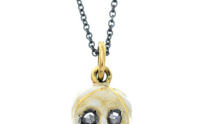A silver enamel skull pendant with 18ct gold bail and rose-cut diamond eyes.