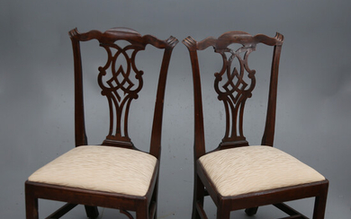 Pair of Chippendale low chairs in inked, carved and openwork beech, circa 1780.