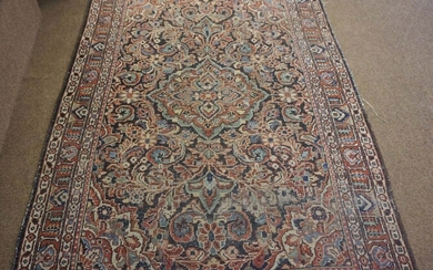 Persian Hand Knotted Rug, Decorated with allover Floral panels on a red, white and blue ground