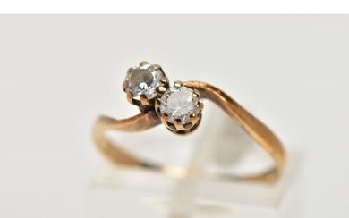 A 9CT GOLD CUBIC ZIRCONIA RING, of a cross over design, set ...