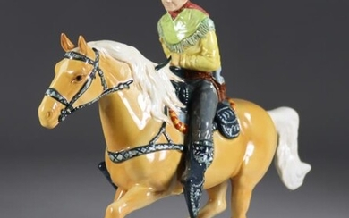 A Beswick Pottery American Mounted Cowboy, designed by Graham...