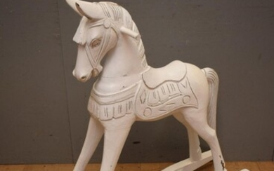 A CARVED TIMBER ROCKING HORSE (A/F) (104H x 29W x 114D CM) (LEONARD JOEL DELIVERY SIZE: LARGE)