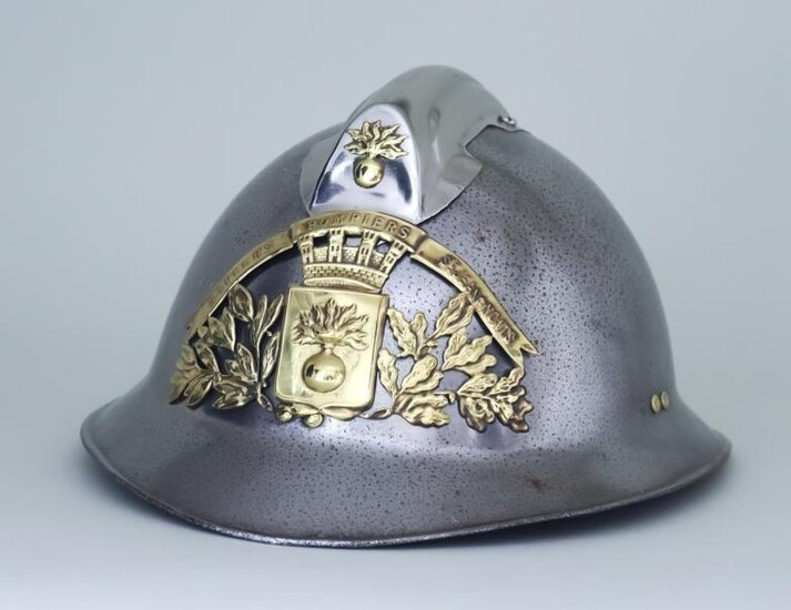 A French Steel Fireman's Helmet with brass crest -...