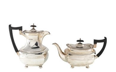 A GEORGE V STYLE PLAIN SILVER COFFEE POT, together with matc...
