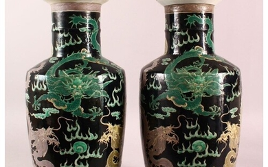 A LARGE PAIR OF CHINESE FAMILLE NOIR PORCELAIN DRAGON VASES,...