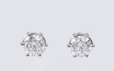 A Pair of Exceptional White Solitaire Earstuds.