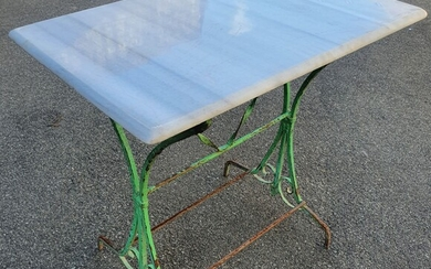 A WROUGHT IRON BASED MARBLE TOP TABLE