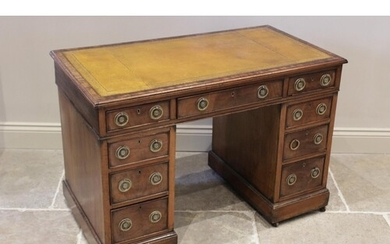 A late 19th century mahogany twin pedestal desk, the rectang...
