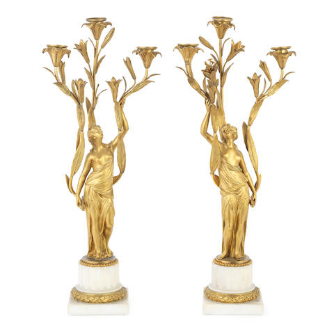 A pair of 19th century French gilt bronze and white marble figural three light candelabra