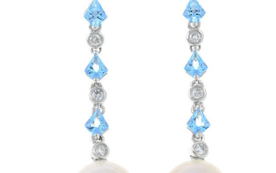 A pair of cultured pearl, diamond and blue topaz earrings.