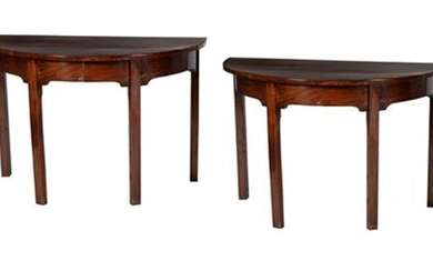 A pair of early George III mahogany side tables