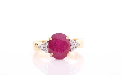 A yellow metal, diamond, and ruby ring, set with a mixed ova...