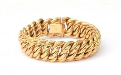 An 18 karat gold Bismarck bracelet. A wide bracelet with alternating floral decorated links and plain links to a tongue clasp and safety eye. Provenance: Italy, ca. 1950. Gross weight: 47.6 g.