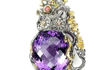 An amethyst brooch set with a fancy-cut amethyst and numerous circular-cut sapphires and chrome diopsides, mounted in rhodium plated sterling silver. – Bruun Rasmussen Auctioneers of Fine Art