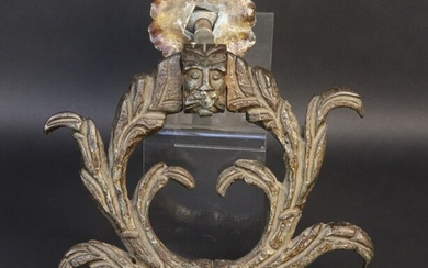 Wrought iron knocker. Leafy ring, striker and axis front decorated with grimacing faces. 18th century. Height 17,9 cm