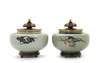 NOT SOLD. Knud Andersen, Kgl. P.: A pair of porcelain lidded jars decorated with greenish...