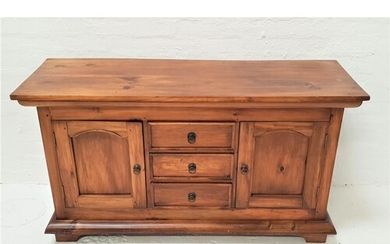 TEAK SIDEBOARD with a plain rectangular top above three cent...