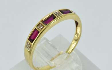 A 9CT GOLD RUBY AND DIAMOND RING