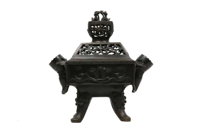 A BRONZE 'MARRIAGE' INCENSE BURNER AND COVER.