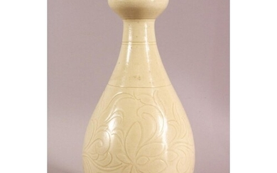 A CHINESE SONG / DING STYLE CARVED PORCELAIN VASE, with scra...