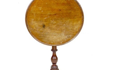 A George III mahogany occasional table, the tilt top dished ...