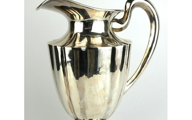 A LARGE STERLING SILVER WATER JUG Fluted design to body, mar...