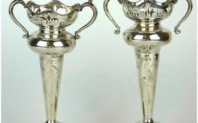 A PAIR OF EARLY 20TH CENTURY SILVER FLOWER VASES Having twin...