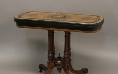 A VICTORIAN AESTHETIC PERIOD CARD TABLE. The rectangular top...