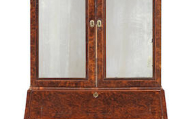 A William III or Queen Anne figured walnut and featherbanded bureau cabinet