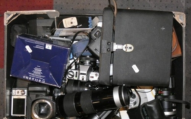 A collection of 35mm film cameras and lenses to include- Min...